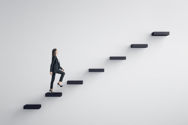 woman walking up floating steps